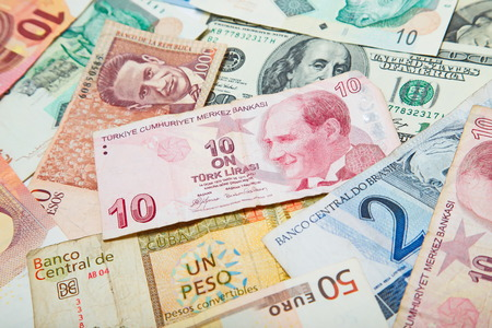 turkish lira: Background from paper money of the different countries. Turkish lira in the middle Stock Photo