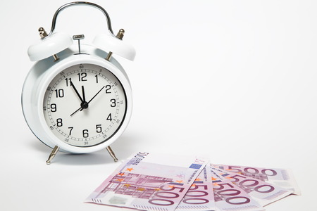 expires: Old Clock and five hundred Euros, European bank withdraws five hundred banknotes.