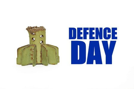 antiwar: Tail of artillery mine on white background with British text DEFENCE DAY Stock Photo