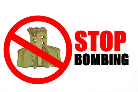 STOP BOMBING sign with Tail of artillery mine Stock Photo