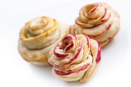 cakes background: Apple Roses made from puff pastry with apple and currant.