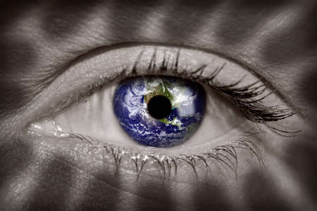 Earth in a womans eye photo