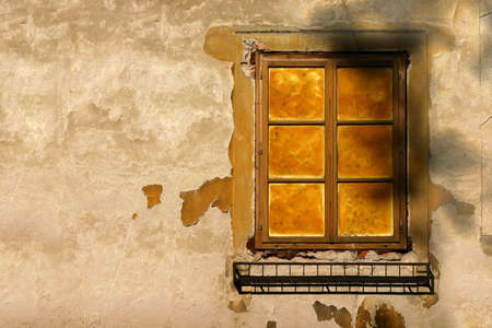 morter: Old window with ruined yellow wall Stock Photo