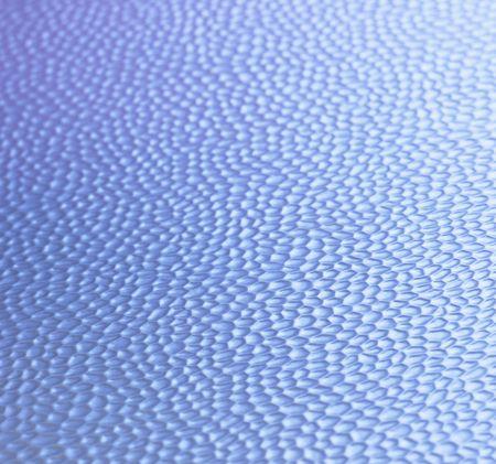 金属の背景に青い反射を打ち出し 写真素材