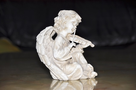Figurine of an angel playing the violin