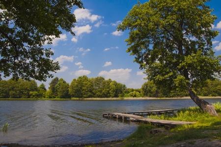 footbridge on the lake Stock Photo