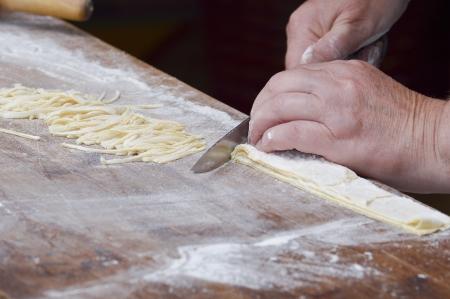 Hand making pasta Stock Photo