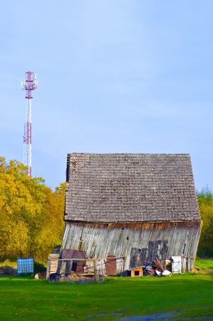 Old barn and the new BTS tower Stock Photo