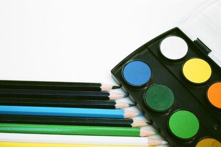 Coloured pencils & paint palette Stok Fotoğraf