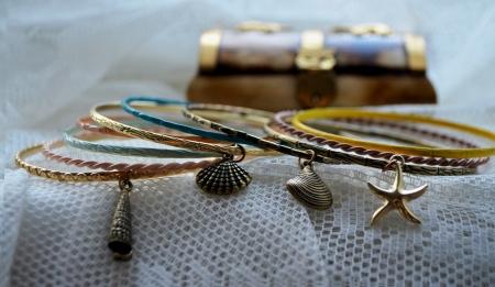 appendage: Bracelets with different pendants Stock Photo