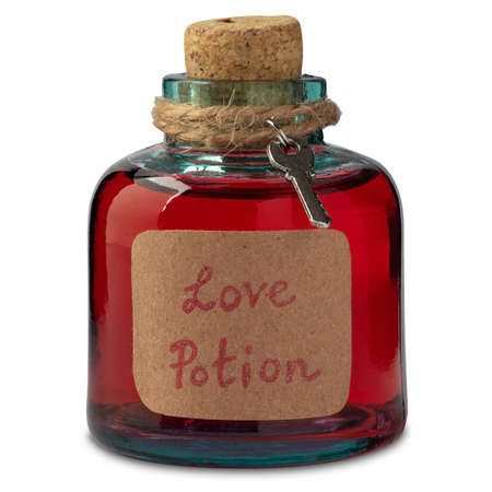 Vintage flask of magical love potion isolated on white