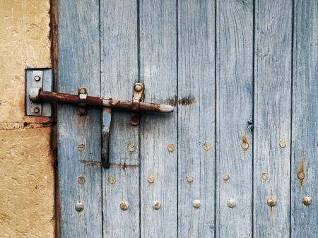 latch: rusty latch on an old blue door