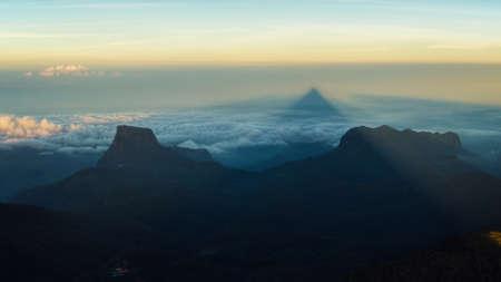 adams: Triangular Shadow of Adams Peak at Sunrise, Sri Lanka Stock Photo