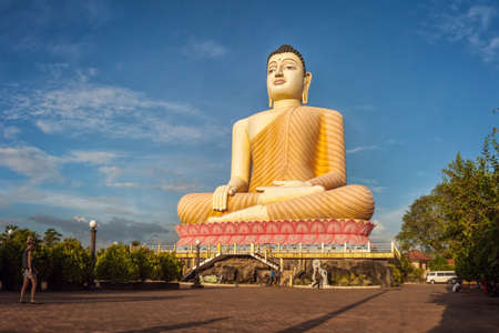 buddha sri lanka: Aluthgama, Sri Lanka - December 28th 2015: Huge - 48 m High - Sitting Buddha Statue in Kande Viharaya Temple in Aluthgama near Popular Tourist Center Bentota and Beruwala.