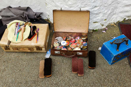 september 9th: PORTMEIRION - WALES - SEPTEMBER 9TH: Shoe shine implements near the Dr Martins shop, during Editorial