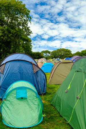 campsite: PORTMEIRION - WALES - SEPTEMBER 6TH: Rows of tents at the campsite -