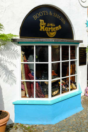 dms: PORTMEIRION, NORTH WALES - SEPTEMBER 7TH: Store front of the Dr Martins shoe store on 7TH September 2014 in Portmeirion, North Wales, UK.