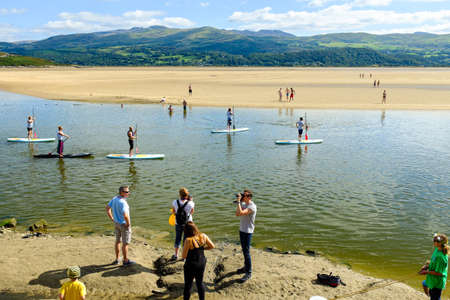 boarders: PORTMEIRION, NORTH WALES - SEPTEMBER 7TH: Paddle Boarders (courtesy of Volvo cars sponsorship) on the estuary, on 7TH September 2014 in Portmeirion, North Wales, UK.