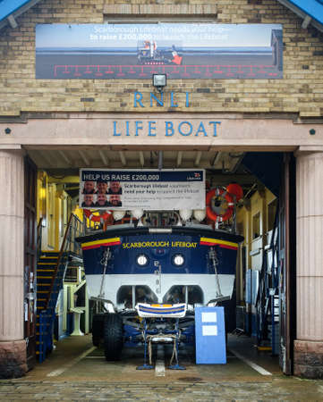 lifeboat station: SCARBOROUGH, ENGLAND - SEPTEMBER 2014: Lifeboat station. 18th September 2014, in Scarborough fishing harbour, England. Editorial