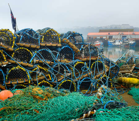 trawler net: SCARBOROUGH, ENGLAND - SEPTEMBER 2014: Lobster pots Scarborough fishing harbour. 18th September 2014, in Scarborough fishing harbour, England.