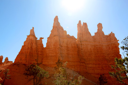 Hoodoos silhouetted against summer sky in Bryce Canyon National Park