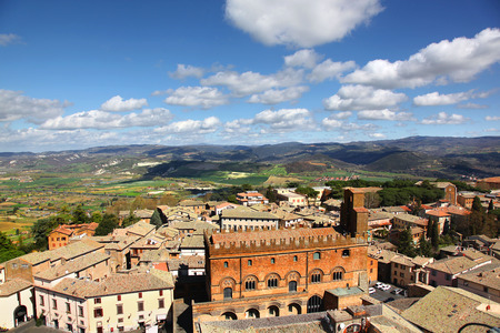 Aerial view of the roof tops and rolling green hills of Orvieto Italy
