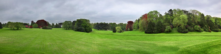 Panoramic view of the manicured lawn and immaculate gardens and trees of the Royal Castle of Laeken in Brussels Belgium