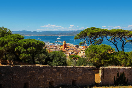 Aerial view of St Tropez old town clock tower and harbor from the citadel