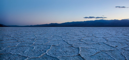 Panoramic view of Bad Water Salt Flats in Death Valley National Park at Sunset
