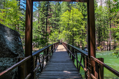 Wooden bridge over the raging King River in Kings Canyon National Park