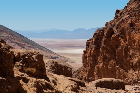 View through canyon of Death Valley basin with mountains and salt flats