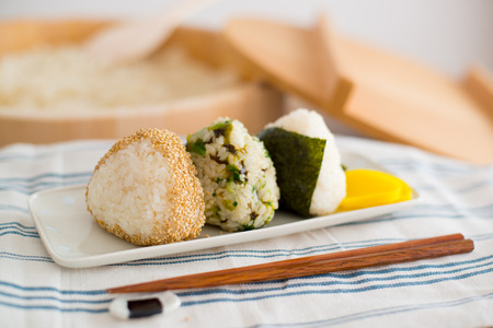 Set of Rice Ball ''Onigiri'' is a typical meal in Japan. Japanese people grab some rice into balls with a shape of triangul in Tokyo, Japan.