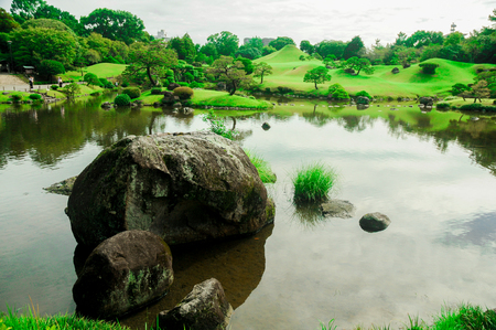 Japanese Garden with Full of Green. The good season for nature to visit Japan is usually from April to November, but you like snowy you should visit here from December to March. Archivio Fotografico - 102144888