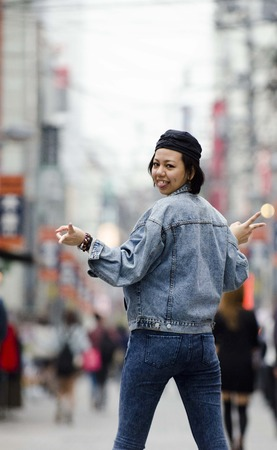 Japanese Girl poses on the street in Machida, Japan. Machida is an area located in Tokyo.