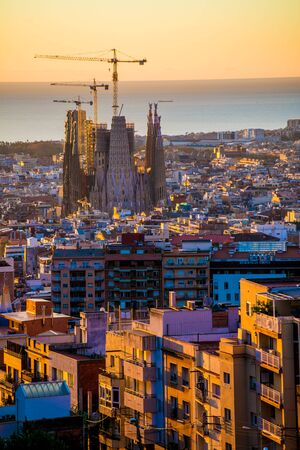 BARCELONA, SPAIN - November 24, 2018: La Sagrada Familia's construction in progress. It is on the part of UNESCO World Heritage site by an artist Antoni Gaudi. Imagens