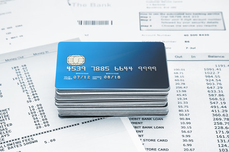 credit crunch: stack of Credit Cards on Bank Statements Stock Photo