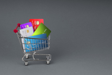 wire pin: A selection off credit cards,bank cards and store cards in a shopping Trolley