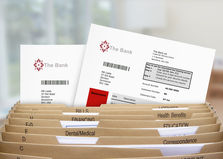 filing system: Home Filing Dividers showing Bank Statements Stock Photo