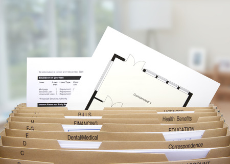 filing system: home filing dividers showing mortgage statements & house floor plans