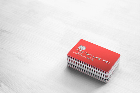stack of Credit Cards on a white wooden table
