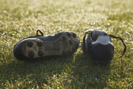 football pitch: football boots on a empty football pitch ,frosty winter morning sunrise Stock Photo
