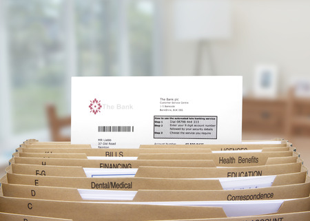 filing system: home filing dividers showing a bank statement Stock Photo
