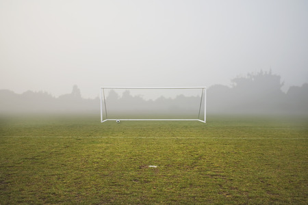 winters: football pitch on a foggy winters day
