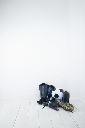 shin: Football equipments: boots, shin pads, football, water bottle and ball pump