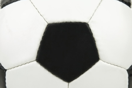 close up shot of a black and white leather football Imagens