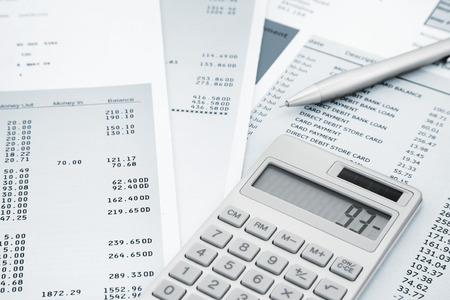 Calculator and Pen on Bank and credit card statements Imagens