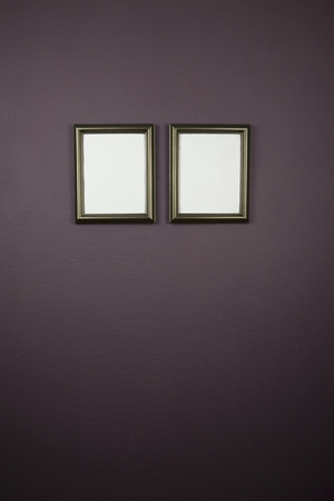 empty picture frames both empty with space for text in side frames,