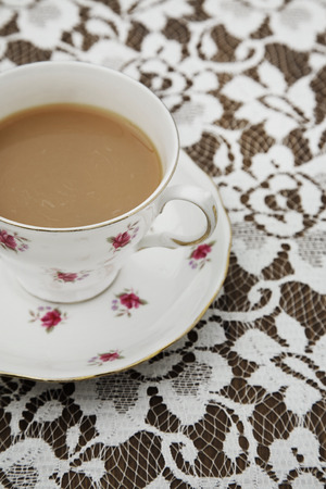 cup and saucer: Vintage tea cup,saucer and tablecloth