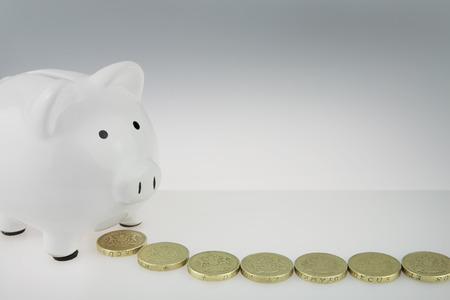 White Piggy bank With British One Pound Coins
