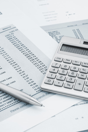 account statements: Calculator and Pen on Bank and credit card statements Stock Photo